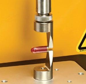 The Capsule Loop Test Fixture is designed to measure the tensile breaking strength of hard gel capsules.